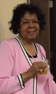 Gloria enjoys a glass of cider at The Women's Center's fall Open House