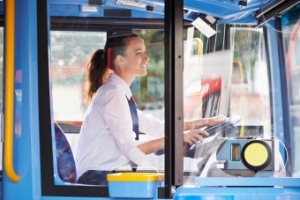 Young white bus driver with ponytail