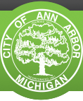 city of ann arbor michigan logo green circle with a tree