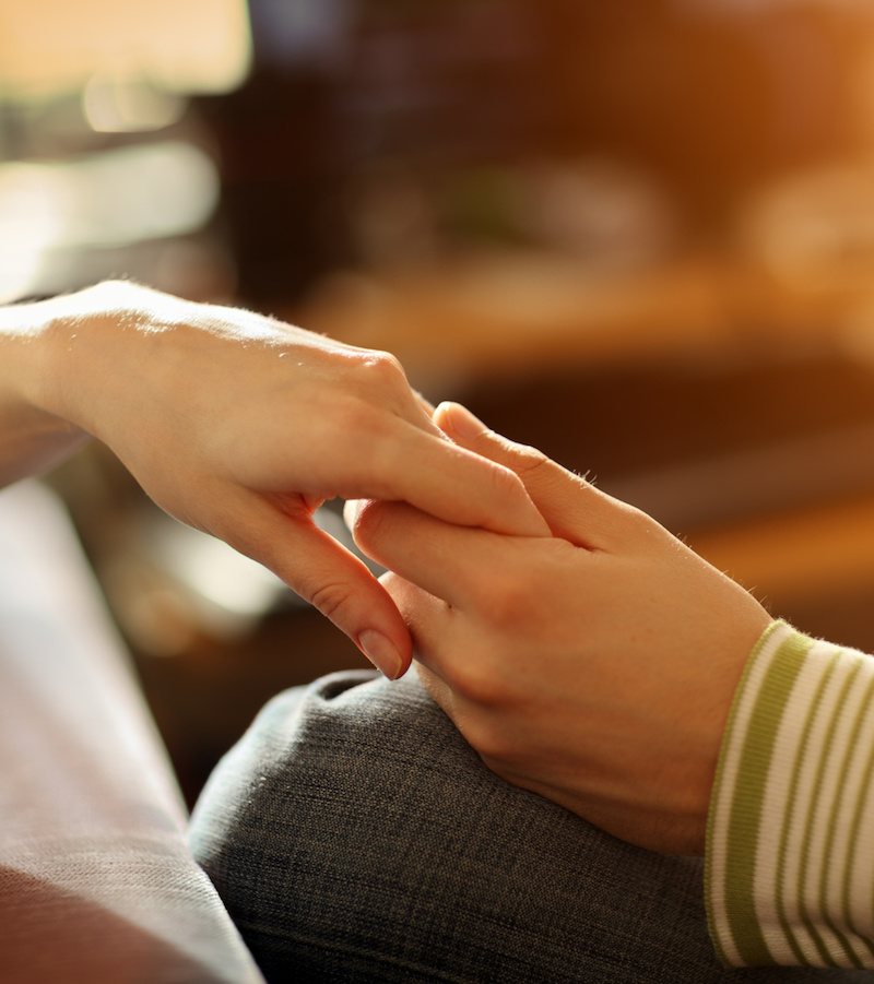 Male and female hands touching. Closeup, shallow DOF.